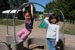 Happy preschool students on a playground.
